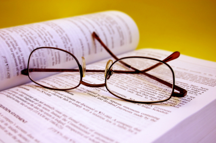 eye glasses on book