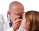 optometrist examining eye