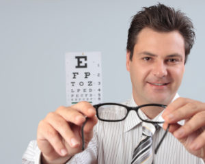 Optometrist holding eye frames
